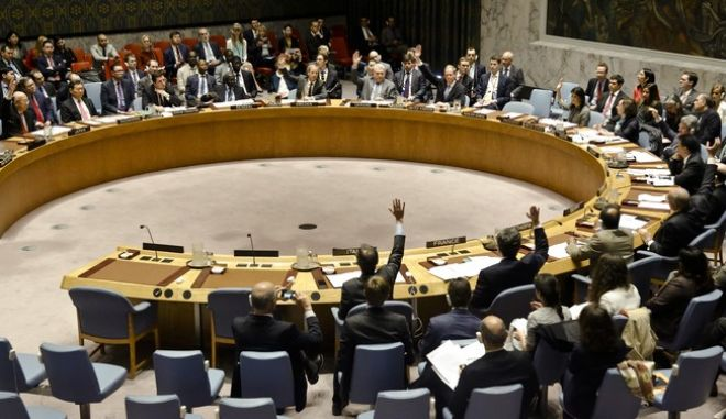United Nations Security Council members show hands for a vote on a resolution condemning Syria's use of chemical weapons at U.N. headquarters on Wednesday, April 5, 2017. (AP Photo/Bebeto Matthews)