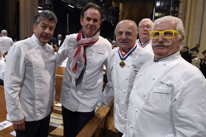 French chefs Regis Marcon, left, Pierre Orsi, 2nd right, Jacques Margui, right, and US chef Thomas Keller, 2nd left, pose before attending the funeral ceremony for French Paul Bocuse at the Saint-Jean cathedral, in Lyon, central France, Friday, Jan . 26, 2018. Hundreds of chefs and French dignitaries are gathering in the culinary mecca of Lyon for the funeral of Paul Bocuse, a master chef who defined French cuisine for more than a half-century and put it on tables around the world. (AP Photo/Philippe Desmazes)