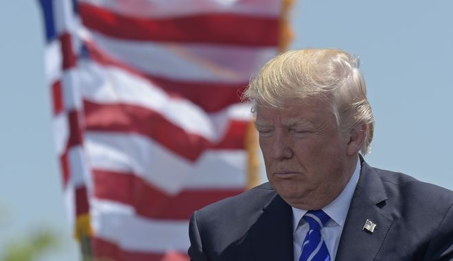 President Donald Trump attends the commencement address at the U.S. Coast Guard Academy in New London, Conn., Wednesday, May 17, 2017. (AP Photo/Susan Walsh)