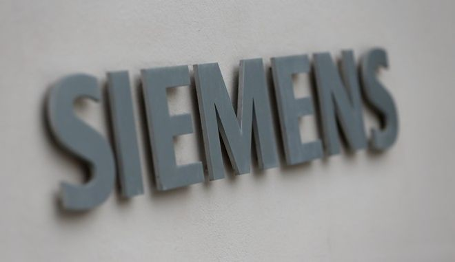The logo of German industrial conglomerate Siemens is pictured outside their headquarters in Munich, southern Germany, on Wednesday, July 31, 2013. (AP Photo/Matthias Schrader)