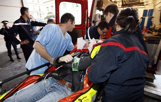 Medics take care of an injured person at the hospital of Nice, southern France, after a train derailed near Digne-les-Bains in the French Alps on February 8, 2014. Two women were killed when a massive falling boulder hit a passing train in the French Alps on Saturday, leaving one of its carriages dangling precariously off a steep, snow-covered embankment. Eight people were injured in the accident which took place as the train travelled from the coastal city of Nice to the popular tourist town of Digne-les-Bains along a narrow, winding, and sometimes breathtakingly steep track. AFP PHOTO / VALERY HACHE