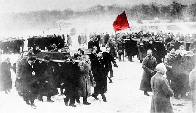 FILE  - In this 1917 file photo, a scene of the Russian Revolution. The tumult that Russia endured in 1917 sent shockwaves around the world as its last czar, Nicholas II, abdicated his throne, and power was later seized by Vladimir Lenins Bolsheviks. A century later, the anniversary is being marked with little official commemoration from the Kremlin. (AP Photo, File)