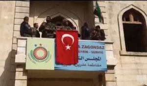 Σόου Ερντογάν στο Αφρίν: Οι Τούρκοι κρέμασαν τουρκικές σημαίες και γκρέμισαν κουρδικά αγάλματα