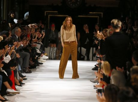 9d318164cee Designer Stella McCartney accepts applause at the end of her Spring/Summer  2018 ready-