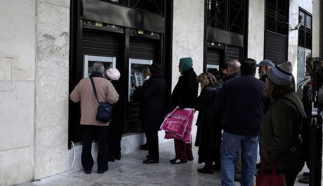 Pensioners queue outside a National Bank of Greece SA bank branch in Thessaloniki, Greece on December 22, 2016.