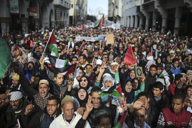 People take part in a rally against U.S. President Donald Trump's decision to recognise Jerusalem as the capital of Israel, in Rabat, Morocco, Sunday, Dec. 10, 2017. (AP Photo/Mosa'ab Elshamy)