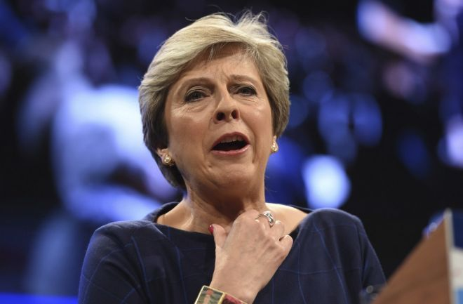 British Prime Minister Theresa May clears her throat as she delivers her keynote speech, during the Conservative Party Conference at the Manchester Central Convention Complex in Manchester, England, Wednesday Oct. 4, 2017. (Joe Giddens/PA via AP)