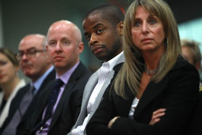Actor Dule Hill, second right, and Bonnie Hammer, President of NBCU Cable Entertainment, right, attend USA Network's National Town Hall  in Washington, on Wednesday, Dec. 2, 2009.  (AP Photo/Jacquelyn Martin)