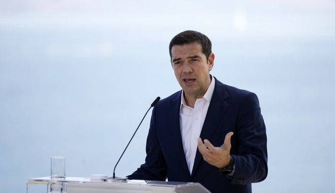 Greek Prime Minister Alexis Tsipras, speaks during a joint news conference with his Italian counterpart during a Greek-Italian Intergovernmental Conference at the museum of Asian art in the island of Corfu, Ionian Sea, Thursday, Sept. 14, 2017. (AP Photo/Petros Giannakouris)