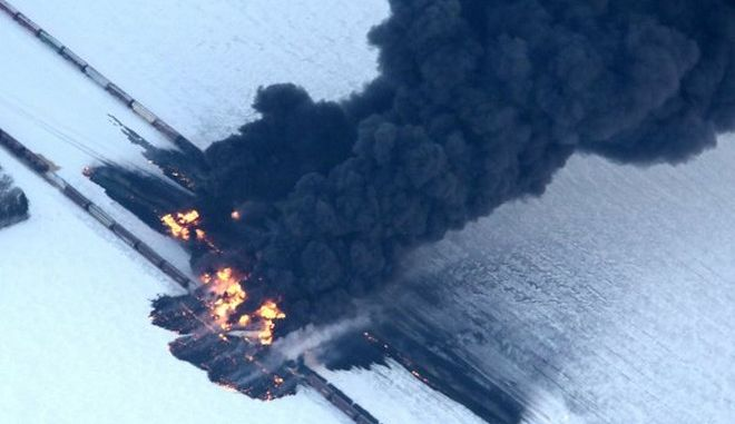 A fire from a train derailment burns uncontrollably as seen in this aerial photograph Monday, Dec. 30, 2013, west of Casselton, N.D. No one has been reported hurt in the derailment or fire. By late Monday afternoon, the smoke plume was diminishing and was staying mostly away from town. (AP Photo/The Forum, Michael Vosburg) ** Usable by LA and DC Only **