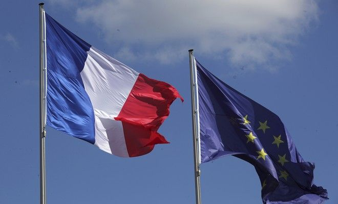 The French and the EU flag  fly prior to the arrival of  French President Emmanuel Macron in Berlin, Germany, Monday, May 15, 2017.  On his first full day in office, French President Emmanuel Macron moved quickly Monday, naming 46-year-old lawmaker Edouard Philippe as his new prime minister before flying off to Berlin for talks with Chancellor Angela Merkel.  (Michael Kappeler/dpa via AP)