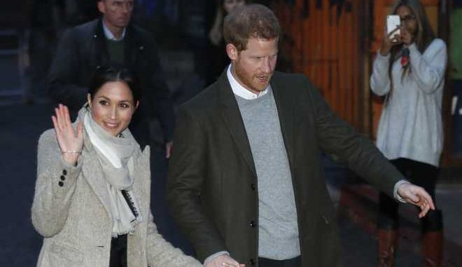 Britain's Prince Harry and his fiancee Meghan Markle leave after their visit to the Reprezent 107.3 FM radio station in Brixton, south London, Tuesday, Jan. 9, 2018. The royal couple visited Tuesday to see the station's work supporting young people through creative training in radio and broadcasting, and to learn more about their model of using music, radio and media for social impact. (AP Photo/Frank Augstein)