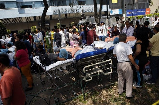CORRECTS BYLINE - Patients lie on their hospital beds after being evacuated following an earthquake in Mexico City, Tuesday, Sept. 19, 2017. A powerful earthquake jolted central Mexico on Tuesday, causing buildings to sway sickeningly in the capital on the anniversary of a 1985 quake that did major damage. (AP Photo/Rebecca Blackwell)