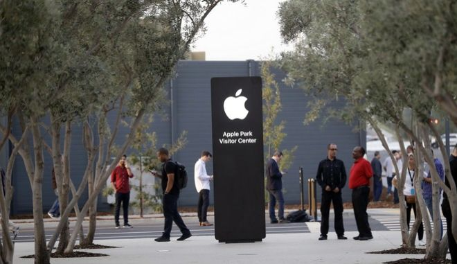 An exterior view of Apple's new visitor center during an announcement of new products Sept. 12, 2017, in Cupertino, Calif. (AP Photo/Marcio Jose Sanchez)