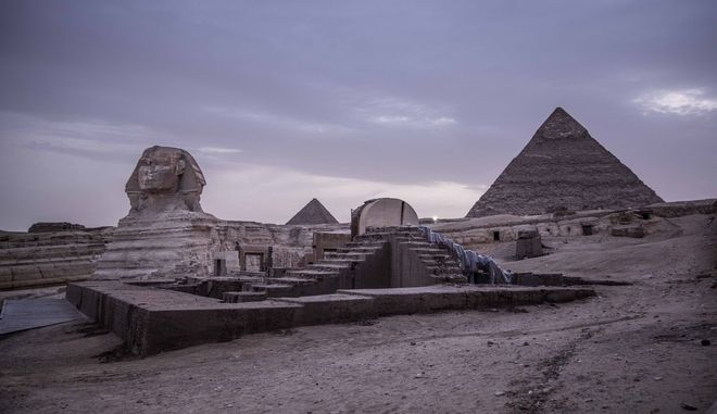 This March 30, 2020 photo, shows the empty Giza Pyramids and Sphinx complex on lockdown due to the coronavirus outbreak in Egypt. Like many other places in the world, the ripples of the worldwide coronavirus pandemic could end up drowning the vulnerable in Egypt. The partial lockdown threatens the livelihoods for many of Egypt's 100 million population, one of three of whom were already living in poverty, according to government figures. (AP Photo/Nariman El-Mofty)