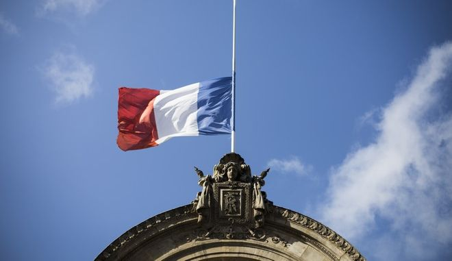 A French flag flies at half-staff for the victims of the Spain attacks, on the Elysee Palace, in Paris, Saturday, Aug. 19, 2017. Police on Friday shot and killed five people carrying bomb belts who were connected to the Barcelona van attack, as the manhunt intensified for the perpetrators of Europe's latest rampage claimed by the Islamic State group. (AP Photo/Kamil Zihnioglu)