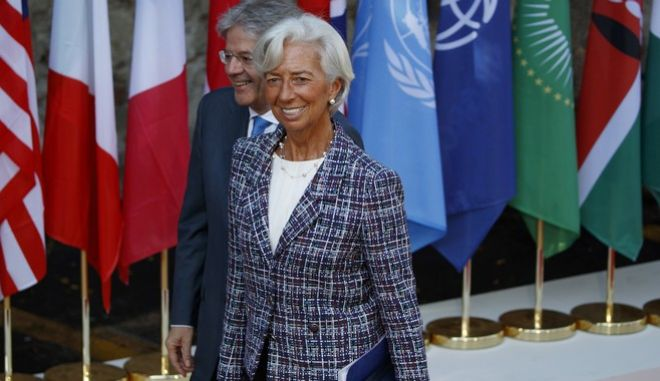 International Monetary Fund Managing Director Christine Lagarde walks with Italian Prime Minister Paolo Gentiloni as she arrives for a working session with outreach countries and international organizations at the G7 Summit, Saturday, May 27, 2017, in Taormina, Italy. (AP Photo/Evan Vucci, Pool)