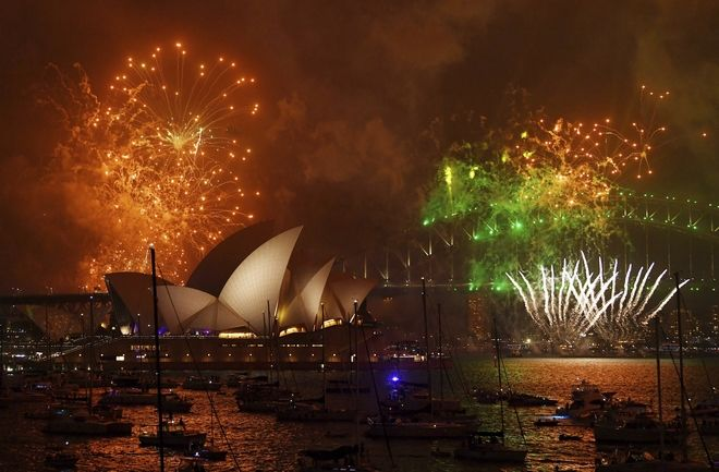 Fireworks explode over Sydney Harbour during New Year's Eve celebrations in Sydney, Australia, Sunday, Dec. 31, 2017. (David Moir/AAP Image via AP)