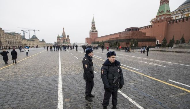 Russian police officers stand ready to prevent any opposition action on Red Square in Moscow, Russia, Sunday, April 2, 2017. Russian prosecutors moved Friday to block calls on social networks for more street protests in Moscow and other Russian cities following a wave of rallies that have cast a new challenge to the Kremlin. (AP Photo/Pavel Golovkin)