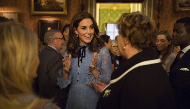 Britain's Kate, the Duchess of Cambridge attend a reception at Buckingham Palace, London, to celebrate World Mental Health Day, Tuesday Oct. 10, 2017. (Heathcliff O'Malley/pool via AP)