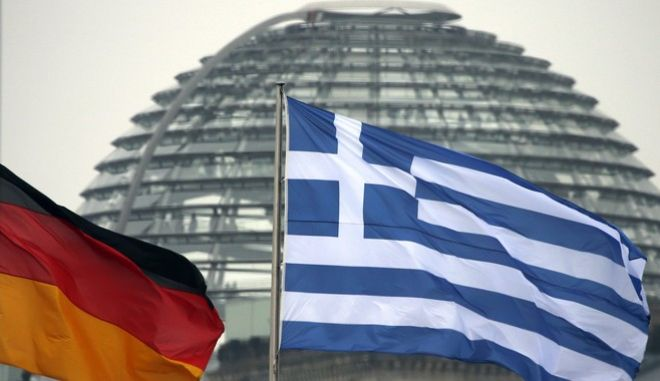 A German and a Greek flag, from left, fly between the chancellery and the Reichstag dome prior to a joint press conference of German Chancellor Angela Merkel and the Prime Minister of Greece, Andonis Samaras after a meeting at the chancellery in Berlin, Germany, Friday, Nov. 22, 2013. (AP Photo/Michael Sohn)