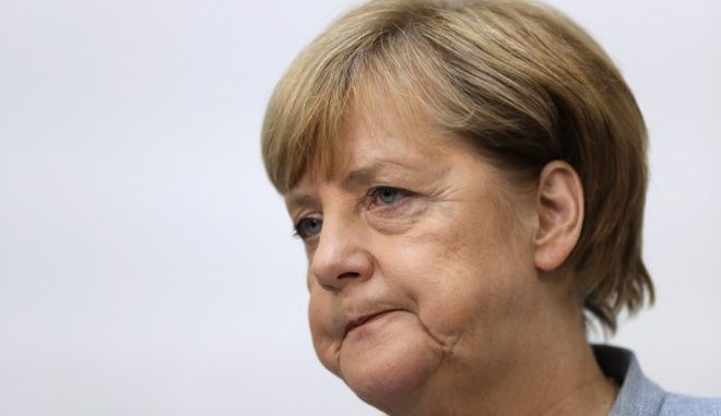 German Chancellor Angela Merkel listens during a press conference after a board meeting of the Christian Democratic Union CDU in Berlin, Germany, Monday, Sept. 25, 2017, the day after the German parliament election. (AP Photo/Matthias Schrader)