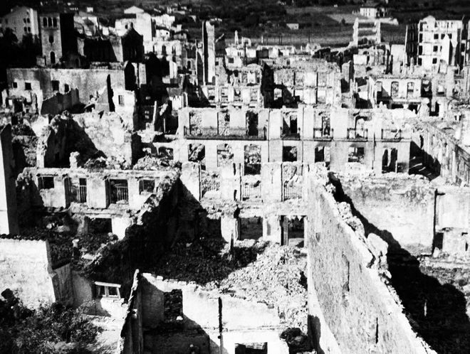 A general view of the shattered ruins of the Basque city of Guernica, Spain, shown, May 1937, after being bombed during the Spanish Civil War.  The city was attacked by planes from the German Luftwaffe and the Italian Fascist Aviazione Legionaria. (AP Photo)