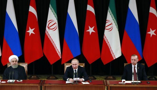 Ερντογάν, Πούτιν και Ροχανί