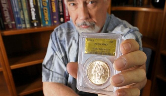 David Hall, co-founder of Professional Coin Grading Service, poses with some of 1,427 Gold-Rush era U.S. gold coins, at his office in Santa Ana, Calif., Tuesday, Feb. 25, 2014.  A California couple out walking their dog on their property stumbled across the modern-day bonanza: $10 million in rare, mint-condition gold coins buried in the shadow of an old tree. Nearly all of the 1,427 coins, dating from 1847 to 1894, are in uncirculated, mint condition, said Hall, who recently authenticated them. Although the face value of the gold pieces only adds up to about $27,000, some of them are so rare that coin experts say they could fetch nearly $1 million apiece.  (AP Photo/Reed Saxon)