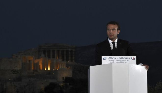 "French President Emmanuel Macron delivers a speech at Pnyx hill as the ancient site of Acropolis is seen in the background in Athens, Thursday, Sept. 7, 2017. Standing at a Greek site where democracy was conceived, French President Emmanuel Macron called on members of the European Union to reboot the 60-year-old bloc with sweeping political reforms or risk a ""slow disintegration. (Aris Messinis/Pool via AP)"
