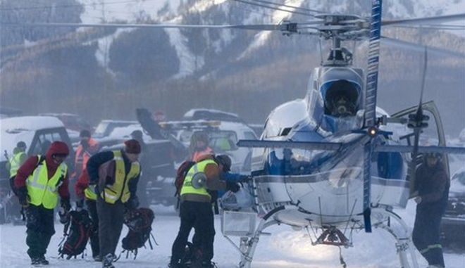 Members of a search and rescue team board a helicopter in Fernie, Canada on Tuesday, Dec. 30, 2008. Search teams recovered the bodies of seven snowmobilers Monday, a day after they were swept away by avalanches in western Canada's backcountry, police said. An eighth man was missing and believed dead. (AP Photo/The Canadian Press, Jonathan Hayward)
