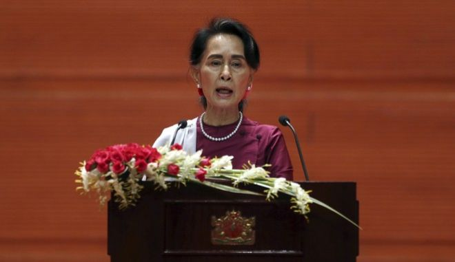 Myanmar's State Counsellor Aung San Suu Kyi delivers a televised speech to the nation at the Myanmar International Convention Center in Naypyitaw, Myanmar, Tuesday, Sept. 19, 2017. Suu Kyi said Tuesday that most Rohingya villages weren't hit by violence. She invited foreign diplomats gathered in the capital for her speech to visit villages that were unaffected. (AP Photo/Aung Shine Oo)