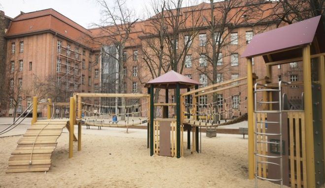 The playground and the courtyard of the closed elementary school Grundschule an der Marie' in empty in Berlin, Germany, on Tuesday morning, March 17, 2020. German government had announced measure to curb the coronavirus outbreak in the country late Monday. For most people, the new coronavirus causes only mild or moderate symptoms, such as fever and cough. For some, especially older adults and people with existing health problems, it can cause more severe illness, including pneumonia.(AP Photo/Markus Schreiber)