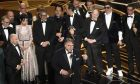 "Guillermo del Toro and the cast and crew of ""The Shape of Water"" accept the award for best picture at the Oscars on Sunday, March 4, 2018, at the Dolby Theatre in Los Angeles. (Photo by Chris Pizzello/Invision/AP)"