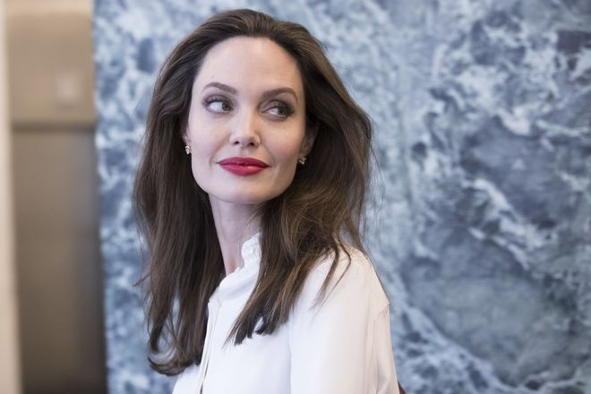 Actress Angelina Jolie leaves the United Nations headquarters after meeting with Secretary-General Antonio Guterres, Thursday, Sept. 14, 2017. (AP Photo/Mary Altaffer)