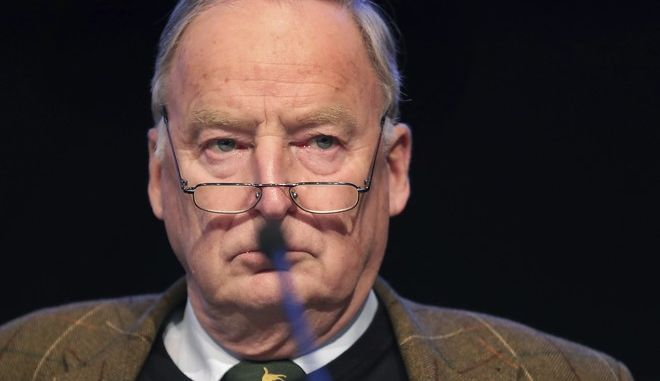 The federal parliament faction co-leader Alexander Gauland attends a party convention of the Alternative for Germany, AfD, party in Hannover, Germany, Saturday, Dec. 2, 2017. (AP Photo/Michael Sohn)