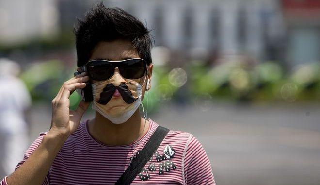 Άνδρας με μάσκα στο Μέξικο Σίτι