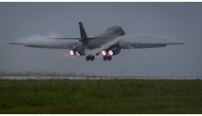 In this photo released by the U.S. Air Force, a U.S. Air Force B-1B Lancer bomber assigned to 37th Expeditionary Bomb Squadron, deployed from Ellsworth Air Force Base, South Dakota, takes off from Andersen Air Force Base, Guam, to fly a mission with two Koku Jieitai (Japan Air Self-Defense Force) F-15s, Sept. 9, 2017. (Senior Airman Jacob Skovo/U.S. Air Force via AP)