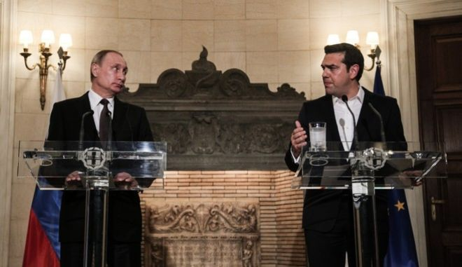 Joint statements between Greece's prime minister Alexis Tsipras and the Russian President Vladimir Putin following their meeting at the Maximos Mansion, in Athens, Greece on May 27, 2016. /                     ,   27  2016.
