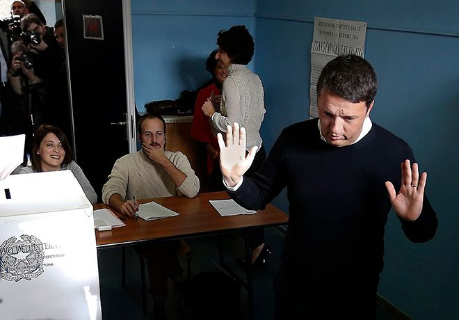 Italian Premier Matteo Renzi gesticulates after casting his ballot at a polling station in Pontassieve, Italy, Sunday, Dec. 4, 2016. Italians voted Sunday in a referendum on constitutional reforms that Premier Matteo Renzi has staked his political future on. Premier Matteo Renzi has said he would resign if the reforms are rejected in Sundays vote, and opposition politicians have vowed to press for a new government if voters reject the proposed constitutional changes. (AP Photo/Antonio Calanni)