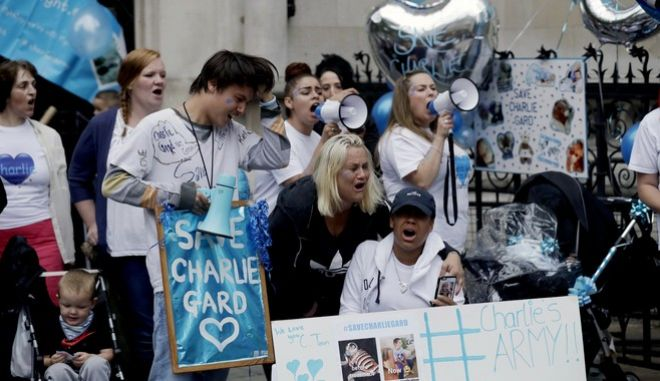 Supporters of critically ill baby Charlie Gard react after hearing his parents had dropped their legal bid at the High Court in London, Monday, July 24, 2017. The parents of critically ill baby Charlie Gard dropped their legal bid Monday to send him to the United States for an experimental treatment after new medical tests showed that the window of opportunity to help him had closed. (AP Photo/Matt Dunham)