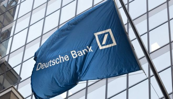 A flag for Deutsche Bank flies outside the German bank's New York offices on Wall Street, Friday, Oct. 7, 2016. (AP Photo/Mark Lennihan)