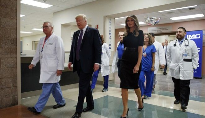 President Donald Trump and first lady Melania Trump walk with surgeon Dr. John Fildes, left, at the University Medical Center after meeting with survivors of the mass shooting Wednesday, Oct. 4, 2017, in Las Vegas. (AP Photo/Evan Vucci)