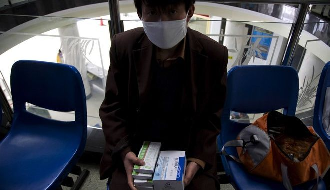**FOR STORY CHINA DANGEROUS TB BY GILLIAN WONG** A tuberculosis patient with his medicine at the Beijing Chest Hospital which specializes in the treatment of tuberculosis in Tongzhou, near Beijing Wednesday, March 25 , 2009. Tuberculosis is posing a new threat in countries like China where highly mobile populations face inadequate public health systems. Strains of TB that don't respond to drugs normally used are spreading, making the ancient disease among the leading killers in the world. (AP Photo/Ng Han Guan)