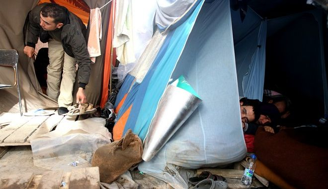 Immigrants are seen inside a tent in the yard of a private building rented by pro-migrant campaigners in Athens, Tuesday, Feb. 8, 2011. More than 200 immigrants have been on hunger strike since Jan. 25, demanding to be legalized by the government. Authorities have ruled out complying with the demand, arguing that Greece is already facing an acute illegal immigration crisis. (AP Photo/Petros Giannakouris)