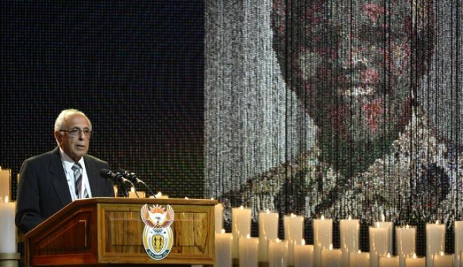 FILE - In this Dec. 15, 2013 file photo, anti-apartheid activist and close friend of Nelson Mandela, Ahmed Kathrada, speaks during the funeral service for the former South African president in Qunu, South Africa. Kathrada died Tuesday, March 28, 2017, after a short illness at the age of 87. (AP Photo/Odd Andersen, Pool, File)