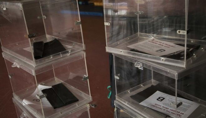 Ballot boxes stacked up inside the multipurpose room of a school, before been set up as a polling station, ahead of the Catalonia voting in Barcelona, Spain, Wednesday, Dec. 20, 2017. As Catalan voters return to the polls on Thursday,  this time to elect a new regional government in an election called by Spain _ the region has been left deeply polarized by the dramatic events that unfolded this fall.  (AP Photo/Emilio Morenatti)