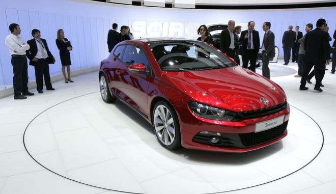 The new Volkswagen Scirocco is shown during the press day at the 78th Geneva International Motor Show, Tuesday, March 4, 2008, in Geneva, Switzerland. The Motor Show will open its doors to the public from March 6 to 16, presenting over 1,000 brands with more than 130 World and European firsts. (AP Photo/Keystone, Martial Trezzini)