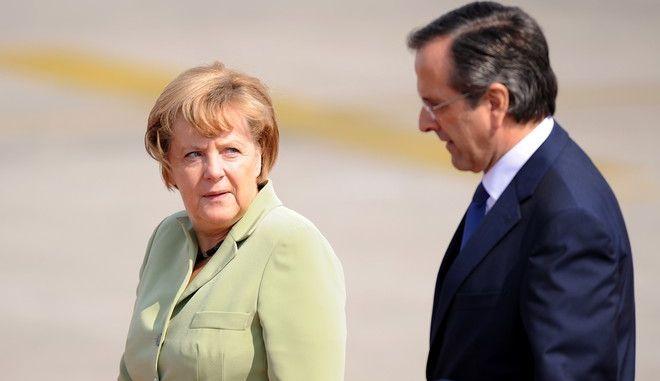 ΑΘΗΝΑ-Η Γερμανίδα καγκελάριος, Άνγκελα Μέρκελ,προσγειώθηκε στο αεροδρόμιο «Ελευθέριος Βενιζέλος», όπου την υποδέχθηκε ο πρωθυπουργός, Αντώνης Σαμαράς, στο πλαίσιο επίσημης τελετής.(EUROKINISSI-ΒΑΣΙΛΗΣ ΚΟΥΤΡΟΥΜΑΝΟΣ)