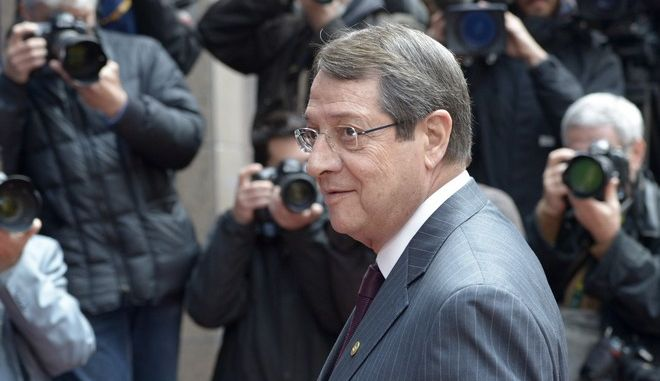 Cypriot President Nikos Anastasiadis arrives at an EU summit in Brussels on Wednesday, May 22, 2013. Leaders from the 27 European Union countries gather in Brussels for one of their regular European Council sessions. On the agenda is the increasingly controversial subject of tax evasion. Countries such as Austria and Luxembourg which have lucrative, and somewhat opaque, banking systems have begun to fight back against efforts to improve the transparency of the EU's financial system. (AP Photo/Ezequiel Scagnetti)